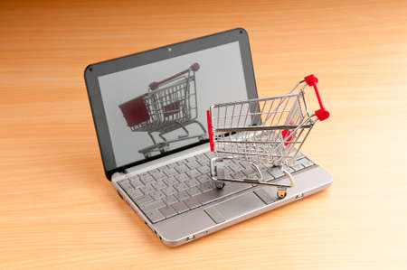 Internet online shopping concept with computer and cart Stock Photo - 10858038