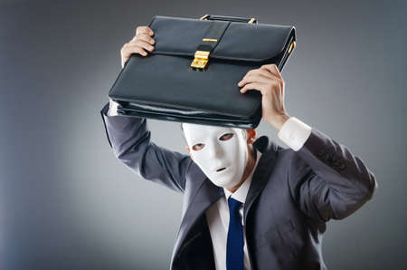 Industrial espionate concept with masked businessman photo