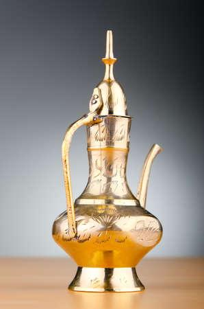 alladdin: Ancient lamp against gradient background Stock Photo
