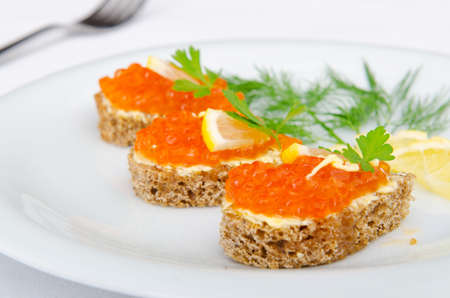 Red caviar served on bread photo