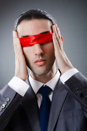 Businessman blinded by red tape photo