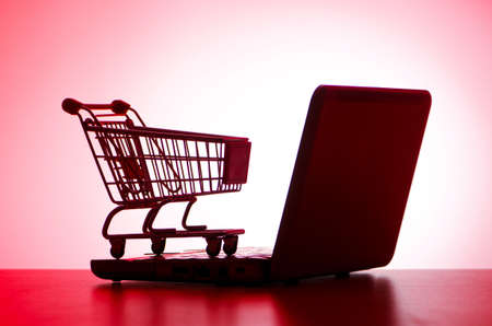 e cart: Shopping cart and laptop