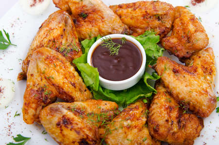 Chicken wings in the plate photo