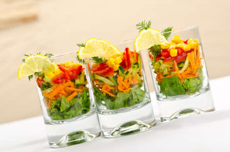 Delicious salad in the plate photo