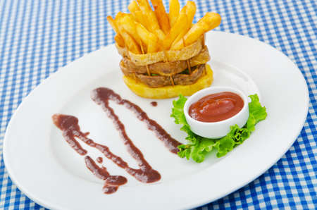 French fries served with ketchup photo