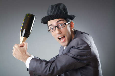 Businessman with bottle of champagne photo