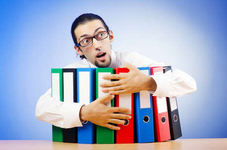 Businessman with many office folders  photo