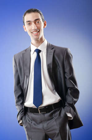 Young businessman in studio shooting Stock Photo - 10969662