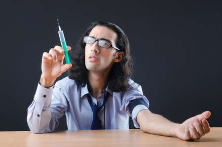 Young druc addict with syringe