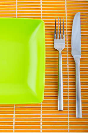 Empty plate with utensils Stock Photo - 10958527