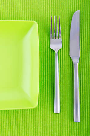 Empty plate with utensils photo