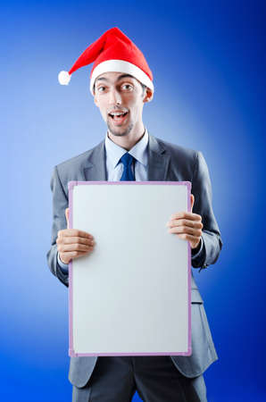 Businessman with santa hat and message photo