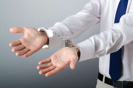 Businessman handcuffed for his crimes Stock Photo - 10961217