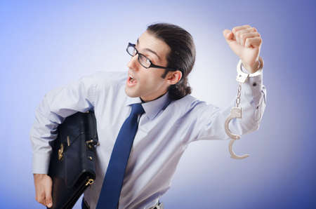 Businessman handcuffed for his crimes Stock Photo - 10970171