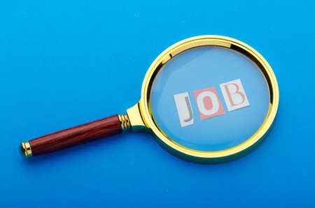 Unemployment concept with magnifying glass Stock Photo - 10958572