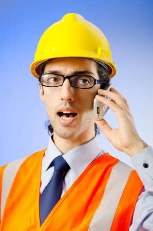 Young construction worker with hard hat Stock Photo - 10969640