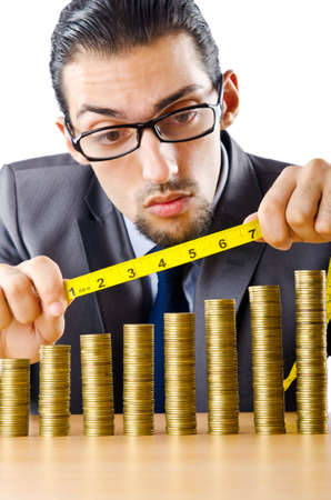 Businessman with golden coins Stock Photo - 10969903