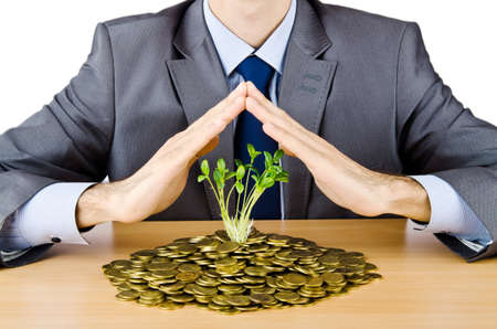 growth protection: Businessman with gold seedlings and coins Stock Photo