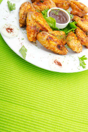 and chicken wings: Chicken wings in the plate Stock Photo