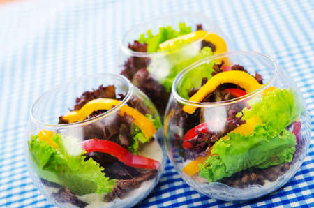 Fresh healthy salad in bowls photo