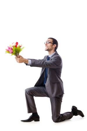 Businessman offering tulip flowers Stock Photo - 10968381