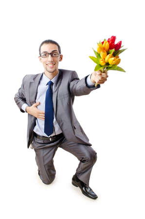 Businessman offering tulip flowers photo