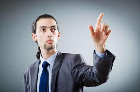 pushing the button: Hombre de negocios presionando los botones virtuales