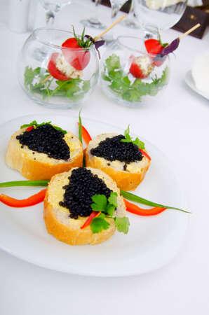 Black caviar in the plate photo