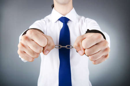 Businessman handcuffed for his crimes Stock Photo - 11075358