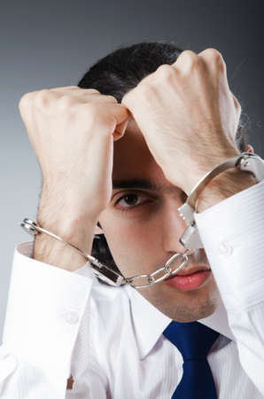 Businessman handcuffed for his crimes Stock Photo - 11127476