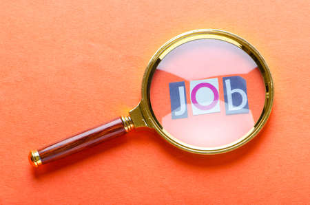 Unemployment concept with magnifying glass Stock Photo - 11074587