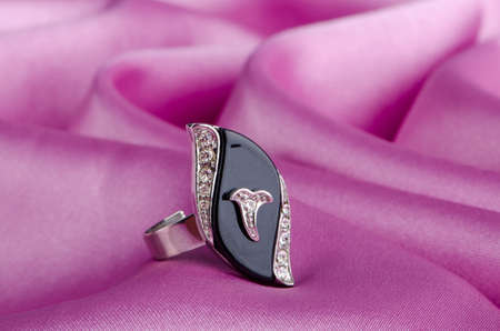 Fashion concept with ring on background photo
