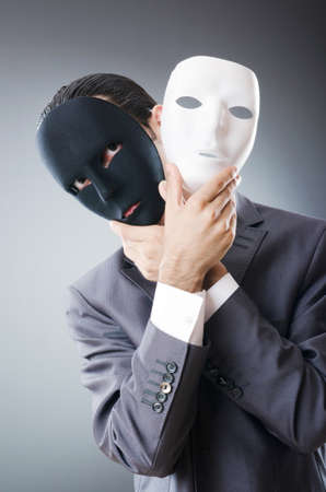 identity thieves: Industrial espionate concept with masked businessman Stock Photo