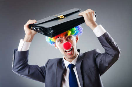 Clown businessman in funny business concept photo