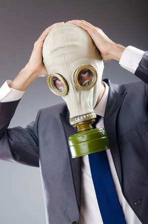 Businessman wearing gas mask photo