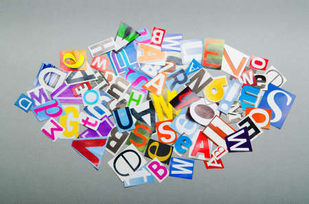 Newspaper clippings with various letters photo