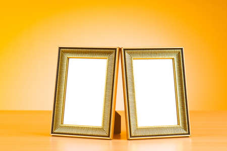 Wooden picture frames on the gradient background photo