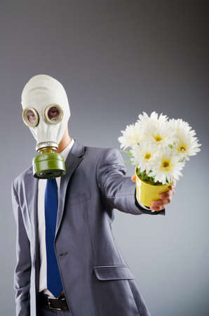 radiation pollution: Businessman with gas mask and flowers