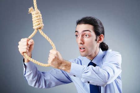 Businessman committing suicide through hanging Stock Photo - 11156866