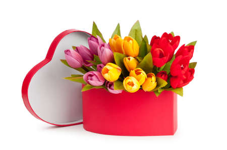 Flowers and gift box isolated on white photo