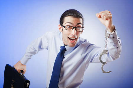 Businessman handcuffed for his crimes Stock Photo - 11156608