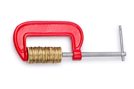 euro screw: Business concept with clamp and coins isolated