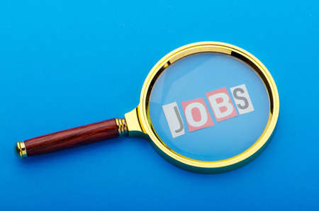 Unemployment concept with magnifying glass Stock Photo - 11129760