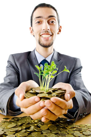 Businessman with gold seedlings and coins Stock Photo - 11156611