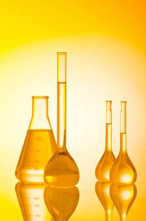 retort: Chemical tubing at gradient background Stock Photo