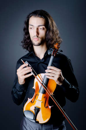 Violin player playing the intstrument Stock Photo - 11156660