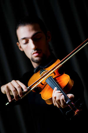 Violin player playing the intstrument Stock Photo - 11156471