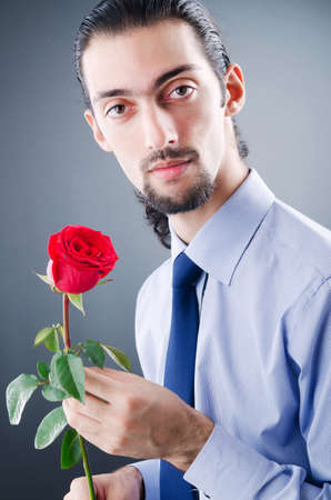 Young man with red rose Stock Photo - 11156895