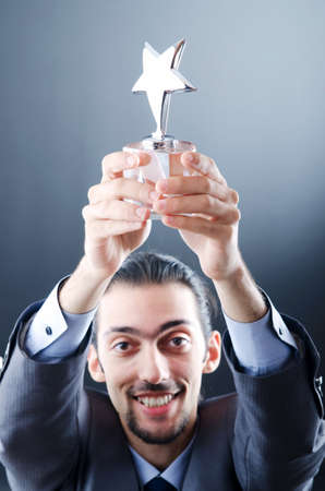 Businessman awarded with star award Stock Photo - 11156620
