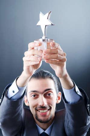 Businessman awarded with star award Stock Photo - 11156620